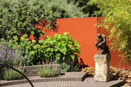 Schutting terracotta - slider - Hermes tuinhuizen
